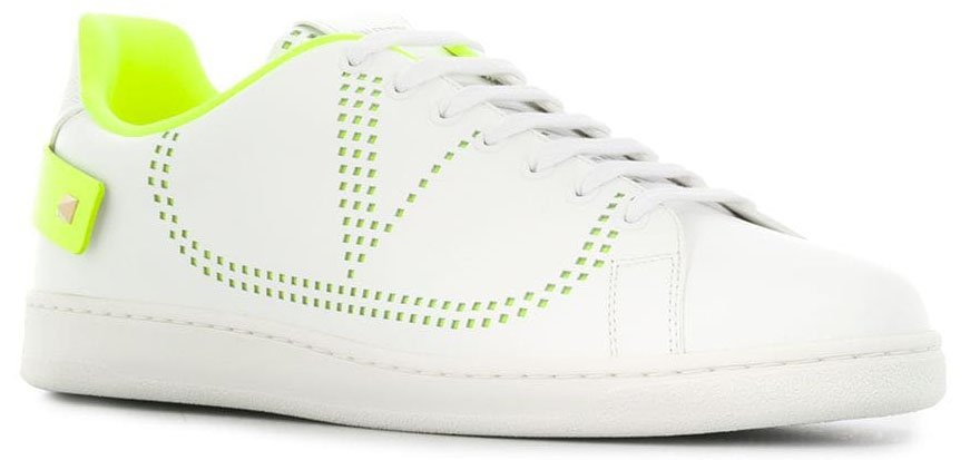Neon accents with V logo and Rockstud-embellished heel straps detail the classic white tennis shoe silhouette