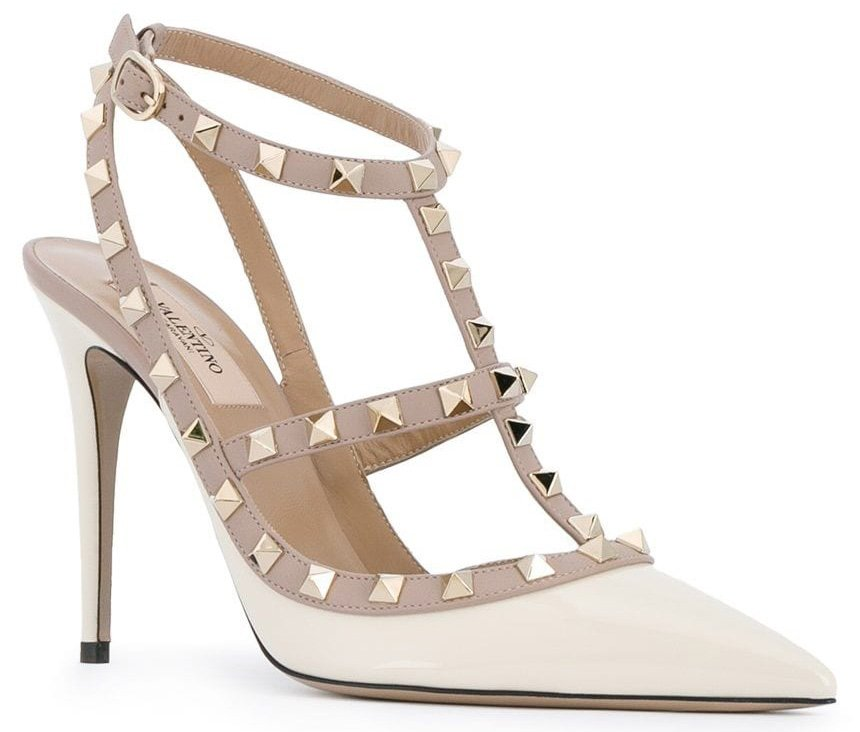 Valentino's signature Rockstud caged pumps in ivory white patent leather with gold-studded beige leather trims