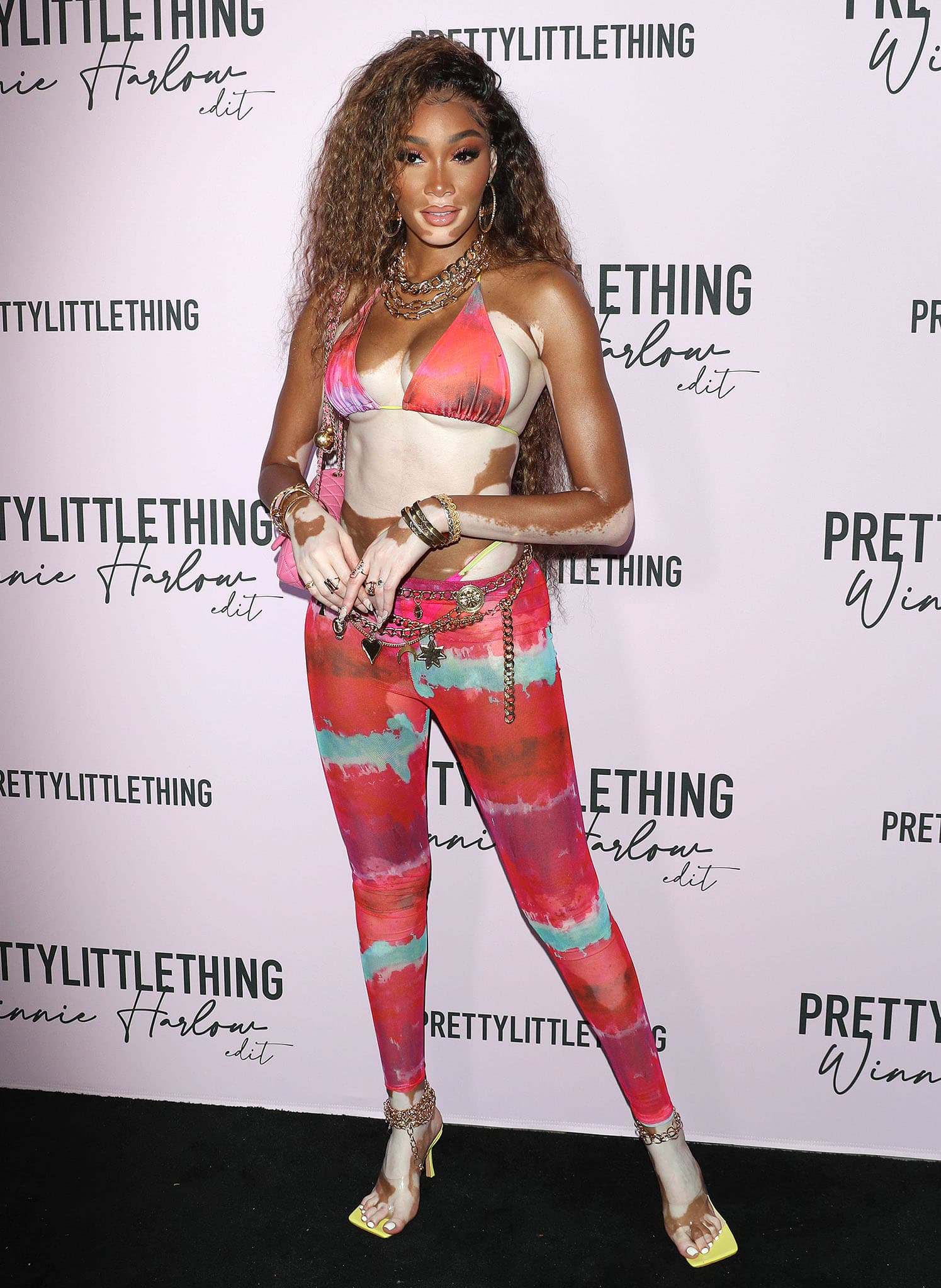 Winnie Harlow shows off her skin and enviable figure in PLT multi-print top and matching leggings
