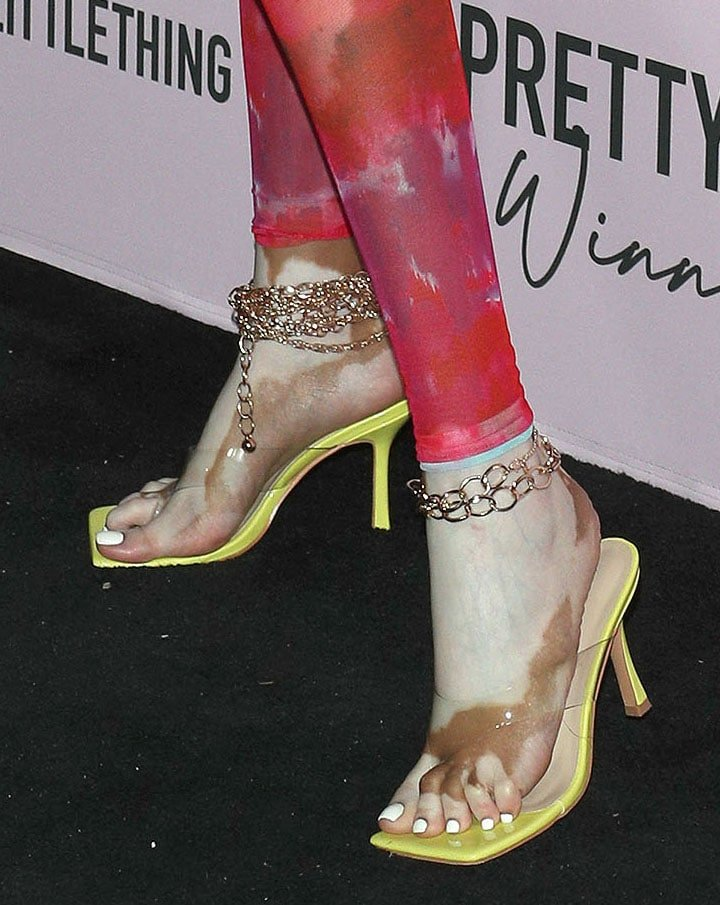 Winnie Harlow shows off her feet in clear thong neon green mule sandals