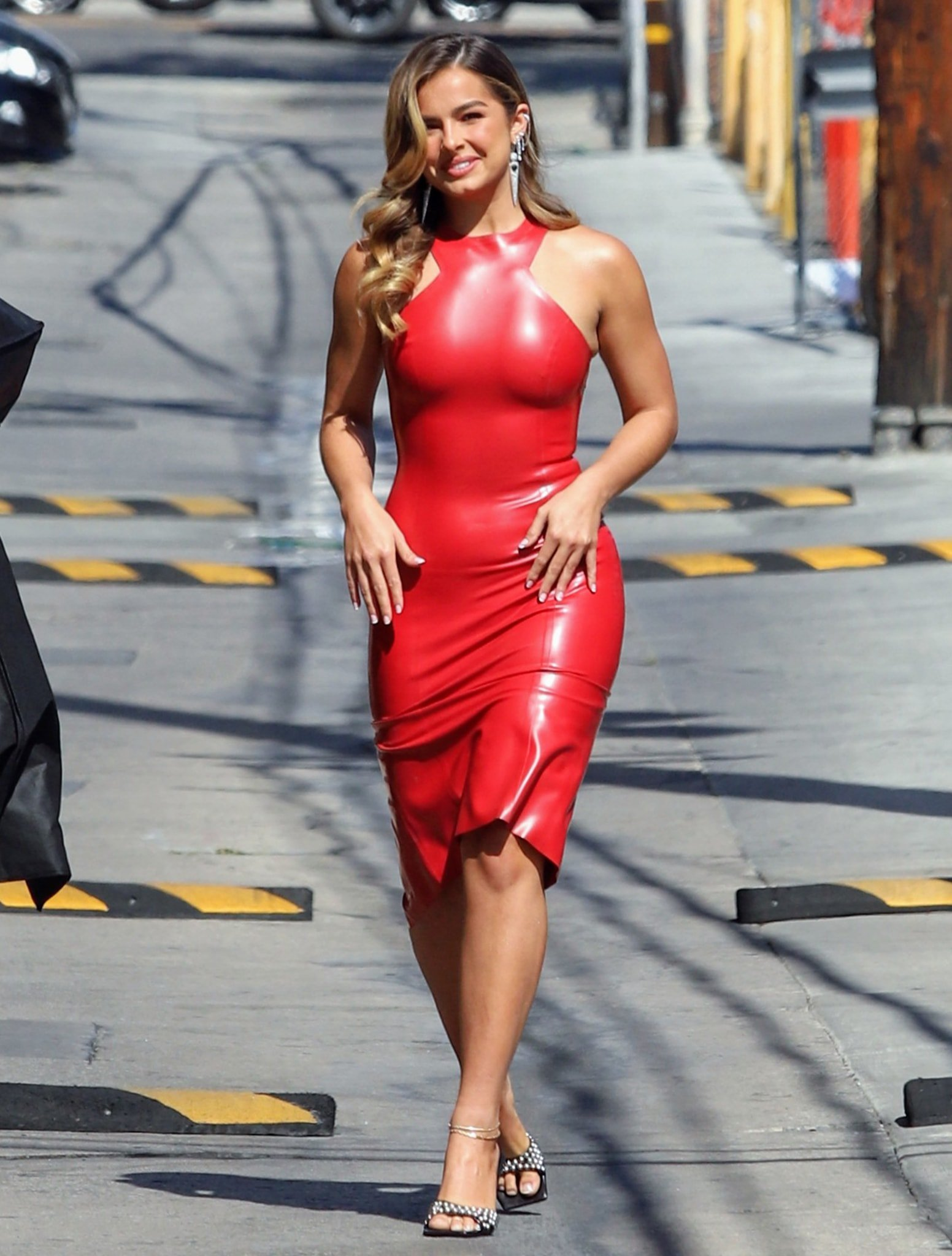 Addison Rae shows off her hourglass curves in Saint Laurent red latex midi dress