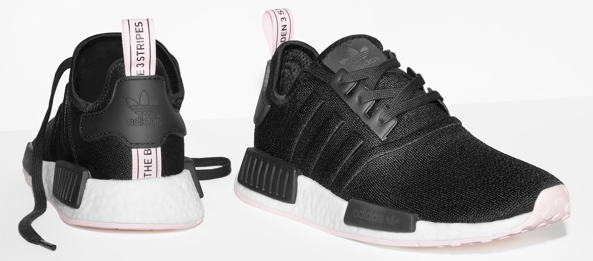 A lightweight pair of shoes made of synthetic mesh with a Boost foam sole