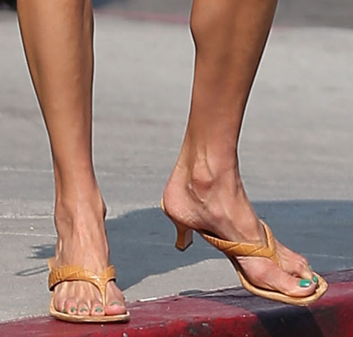 Alessandra Ambrosio completes her summer look by showing off her feet in Paris Texas thong-toe sandals