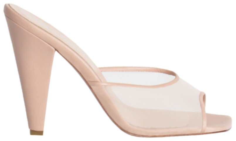 The Andrea Wazen Immy mules have a sheer strap with square toes and cone-shaped heels