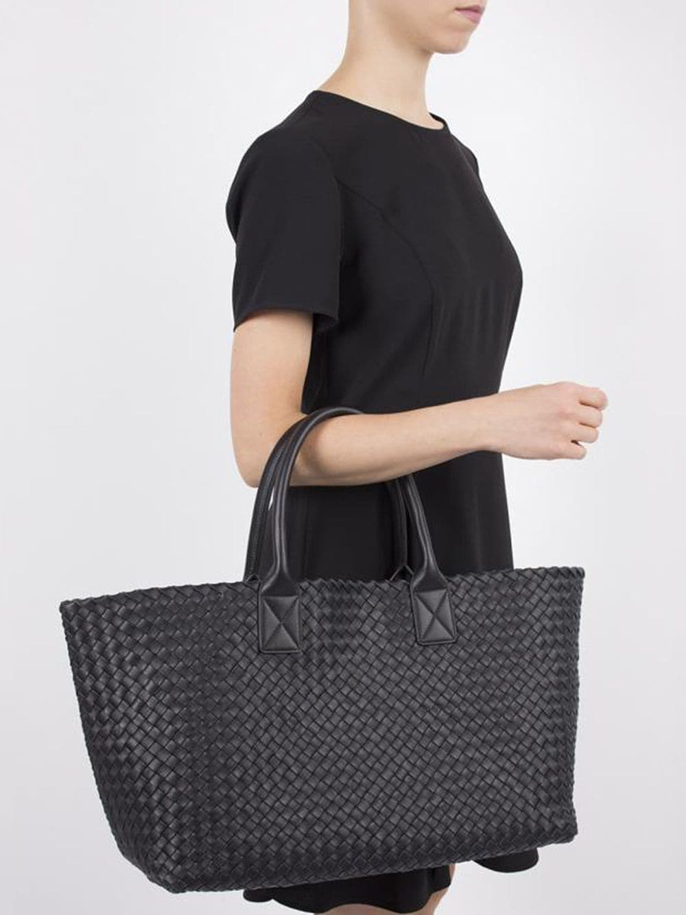 The Cabat tote bag is crafted from weaving about 100 double-faced leather strips