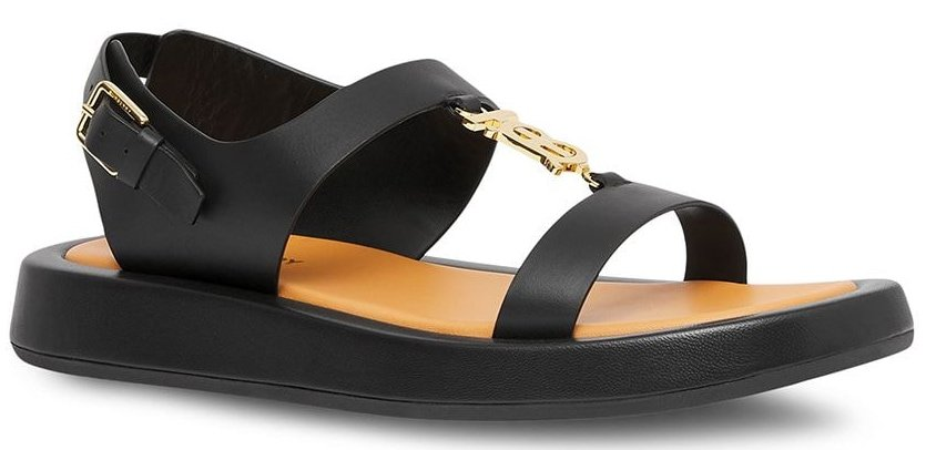 A casual flat sandal that features wide straps, a chunky sole, and Burberry's TB logo plaque