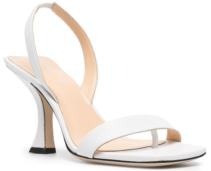 A minimalist pair of white sandals with slingback straps and spool heels