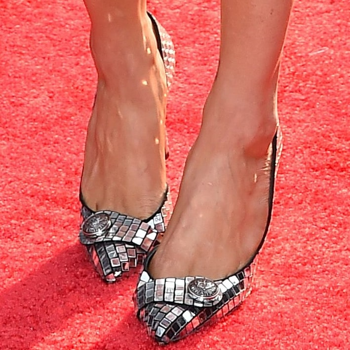 Chrishell Stause shows off her size 8.5 (US) feet in silver disco-ball shoes