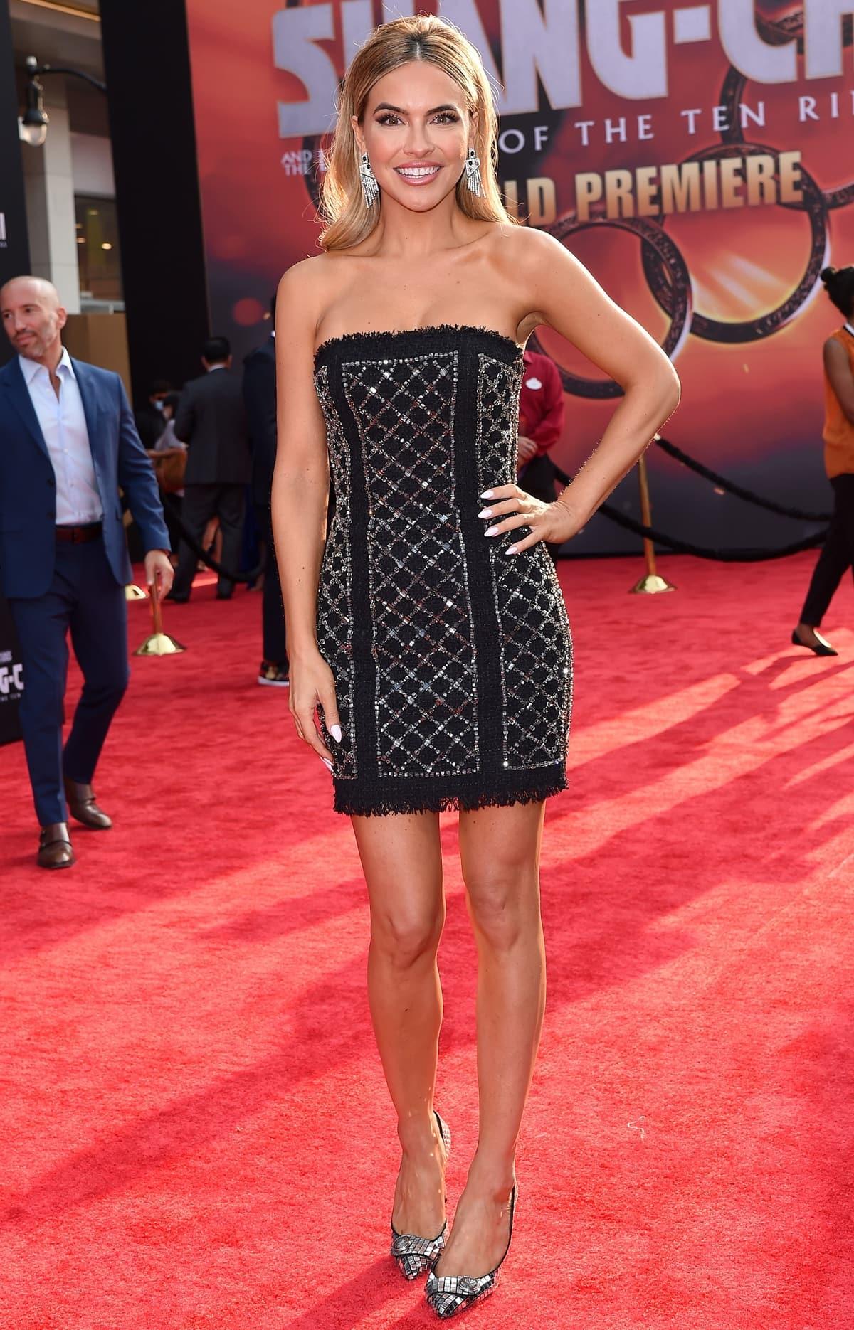 Chrishell Stause flaunts her legs in a black glittering strapless Balmain mini dress