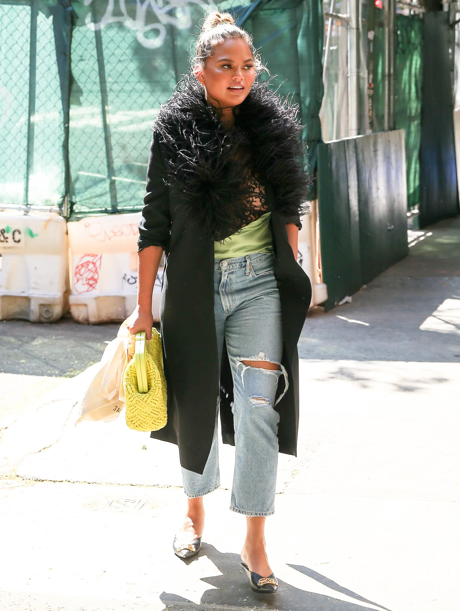 Chrissy Teigen teams her green Gauchere Theophilia lace camisole with Citizens of Humanity Charlotte high-rise straight jeans