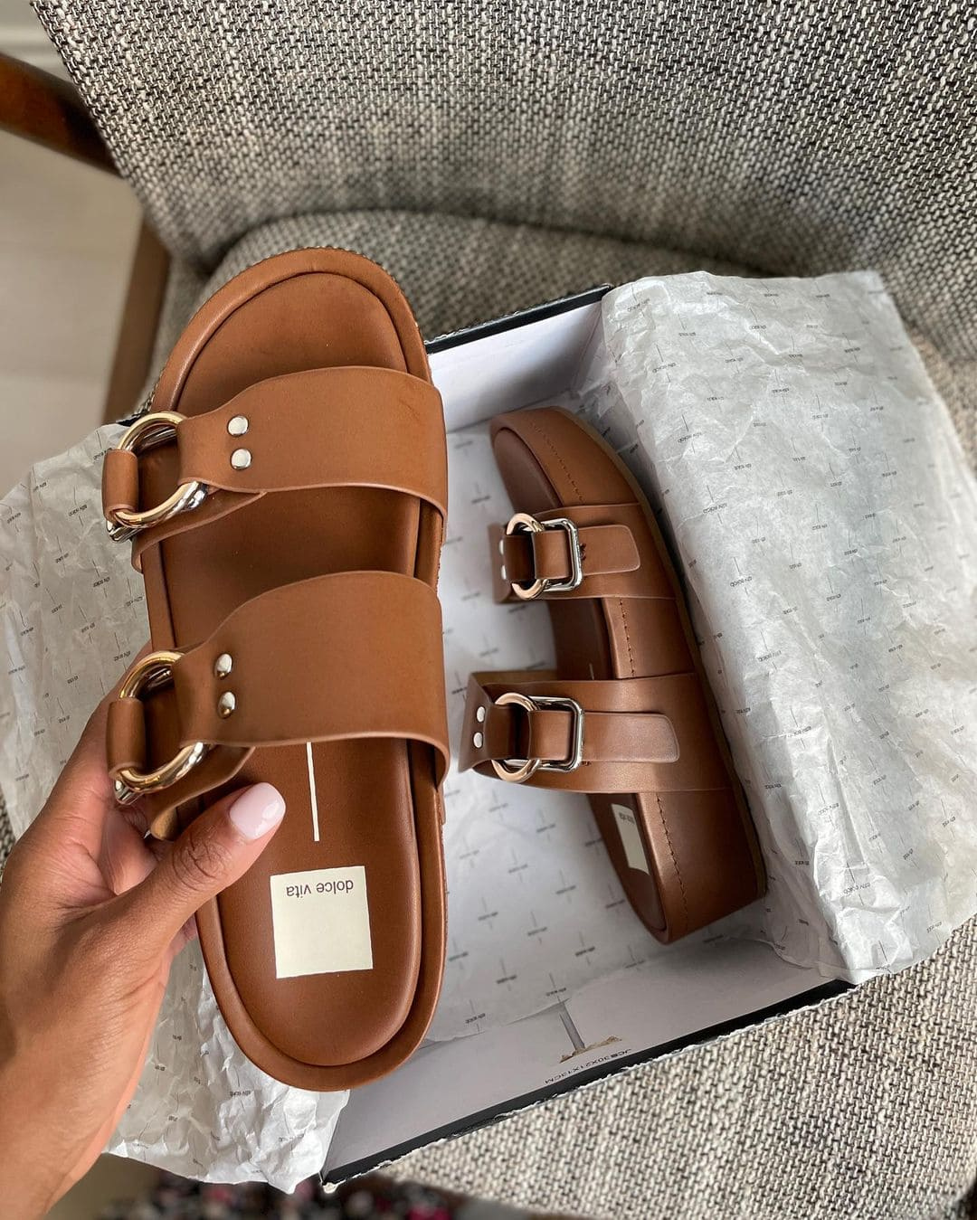 A molded footbed supports your every step from beach bistro to the late-night show in Dolce Vita's double-strap platform sandal with shiny geometric buckles