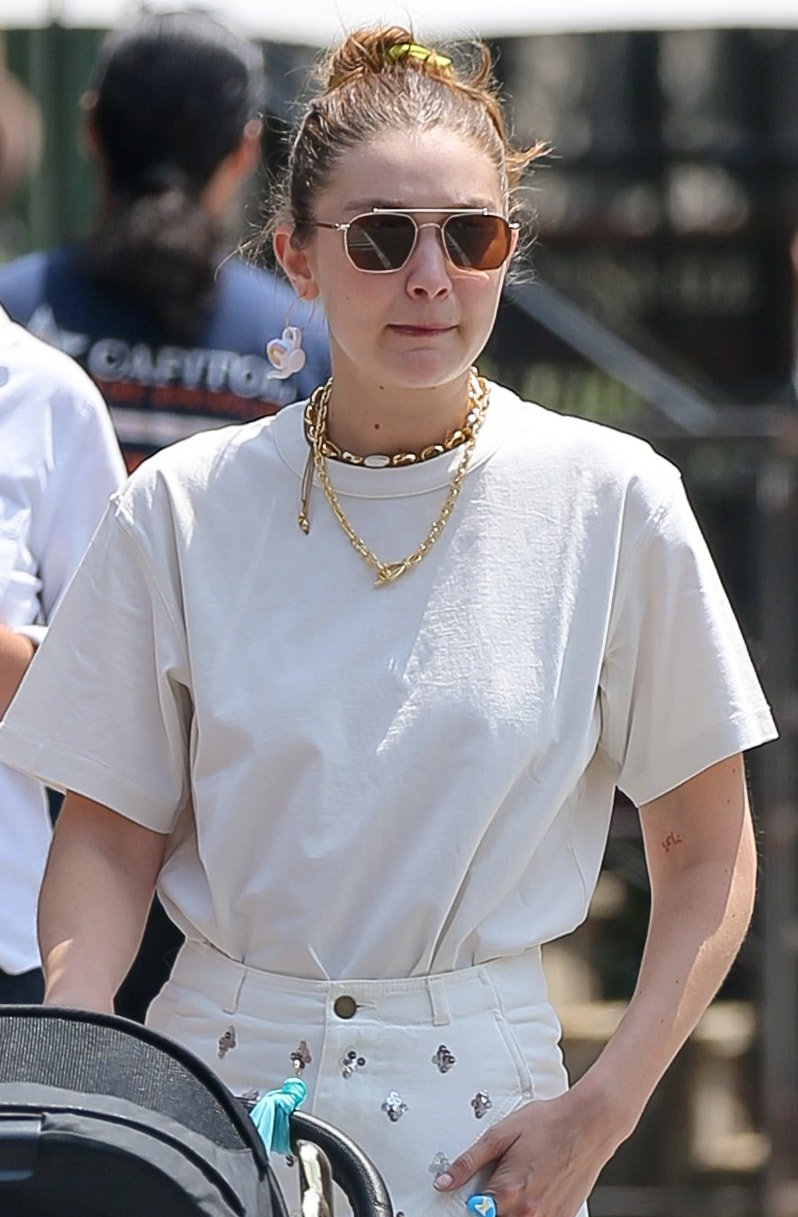 Gigi Hadid sweeps her tresses into a bun and hides her eyes behind Vehla Bowie sunglasses