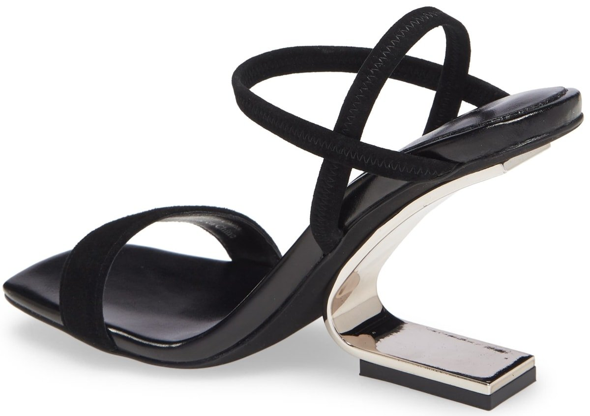 An architectural hidden heel brings striking height to a strappy sandal designed with elasticized straps at the ankle