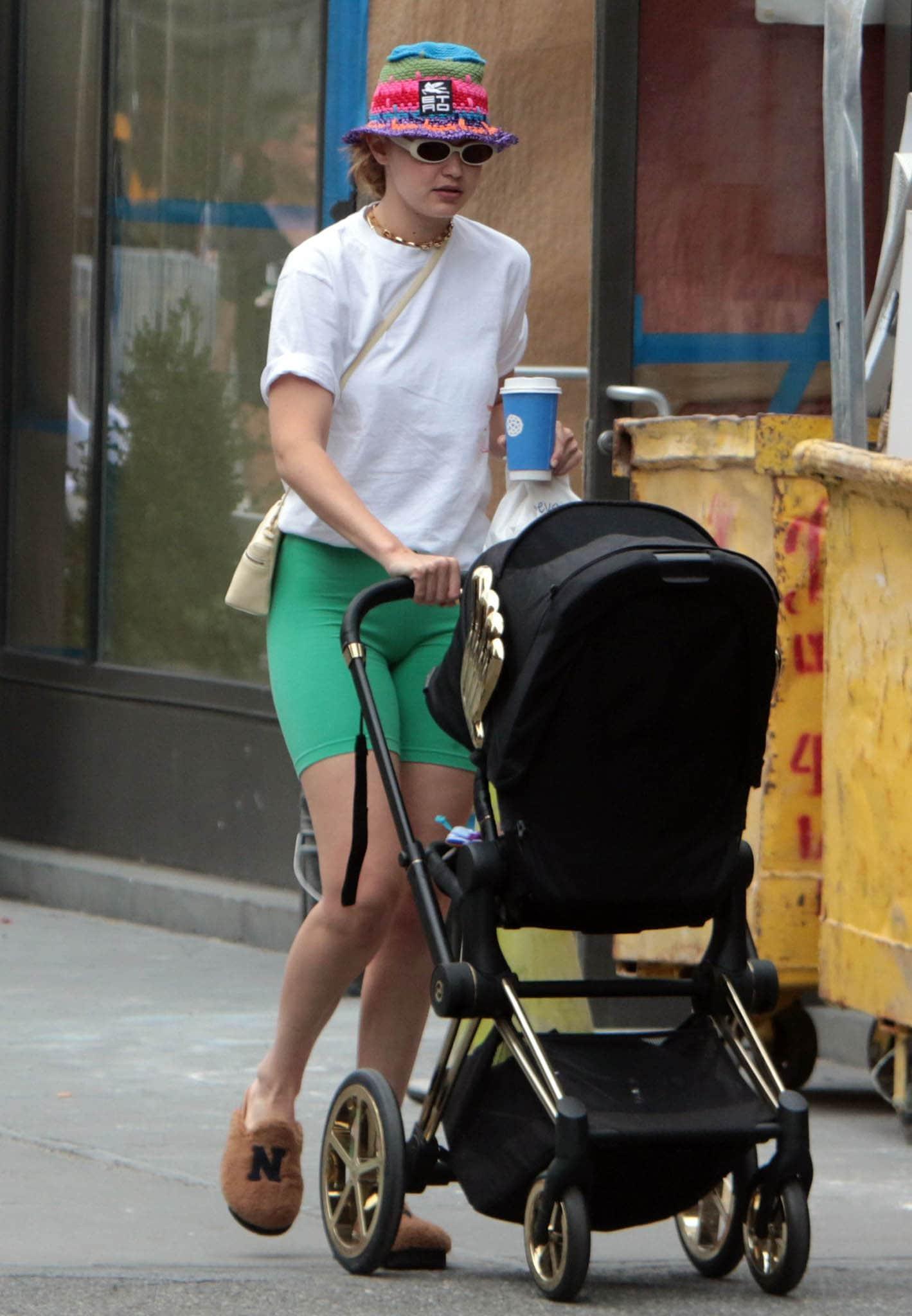 Gigi Hadid strolls around New York City with her daughter Khai on July 29, 2021