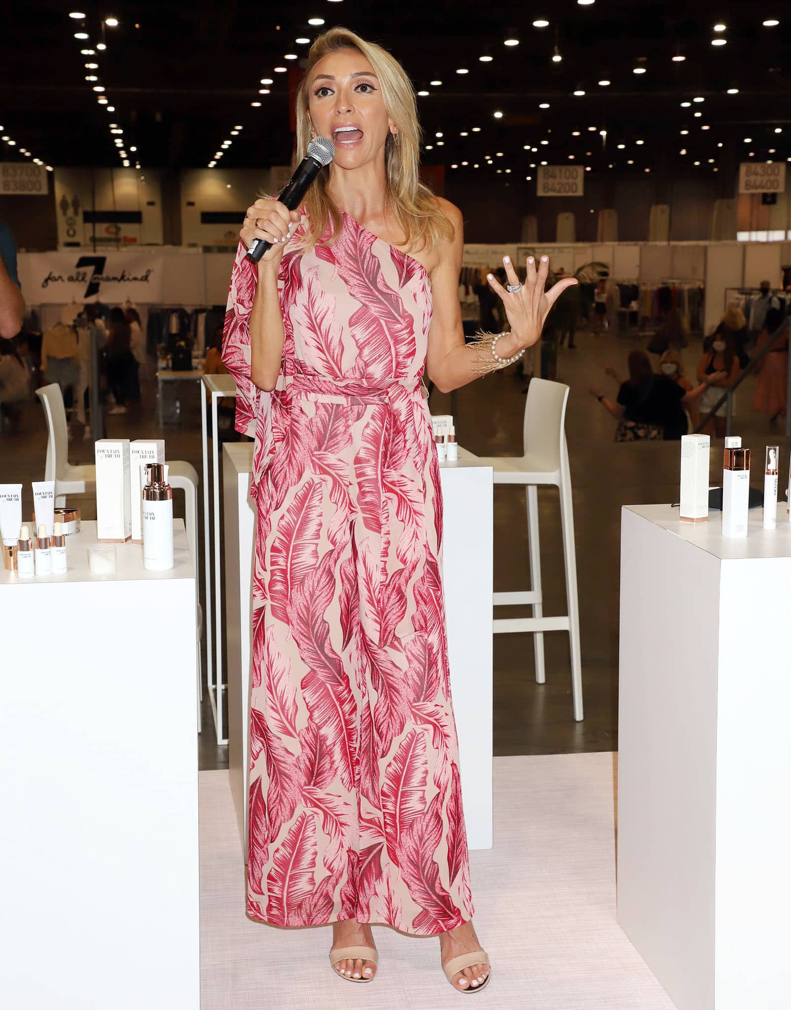 Giuliana Rancic wears a one-shoulder pink jumpsuit from her G by Giuliana clothing label