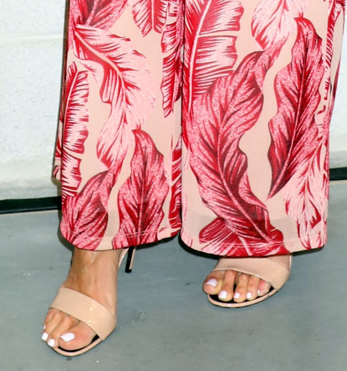 Giuliana Rancic shows off her feet in open-toe patent nude sandals