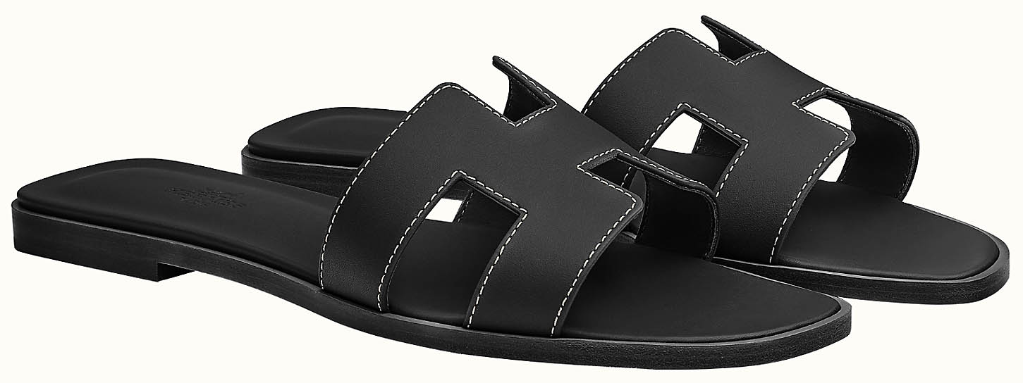Hermes' classic Oran sandals feature the iconic H cutout strap design
