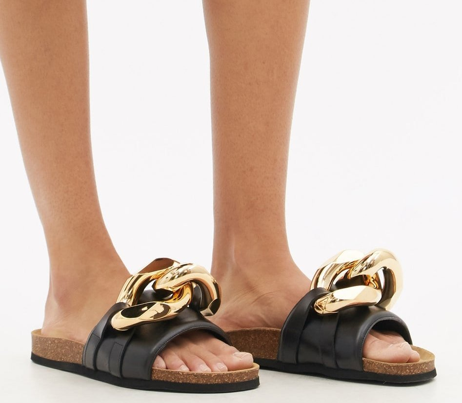 The chunky gold curb chain defines these edgy JW Anderson slides