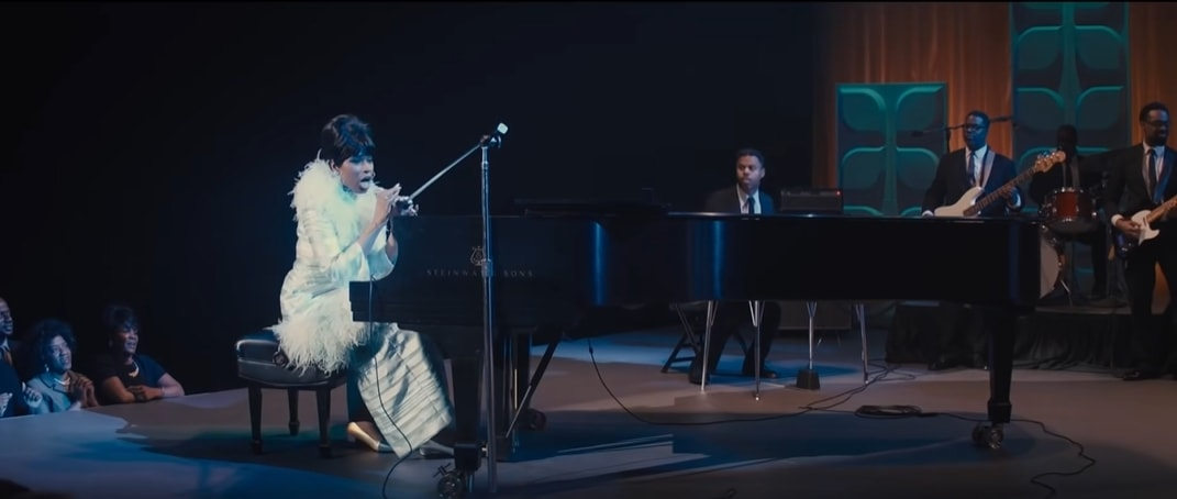 Jennifer Hudson plays piano and does her own singing as Aretha Franklin in Respect