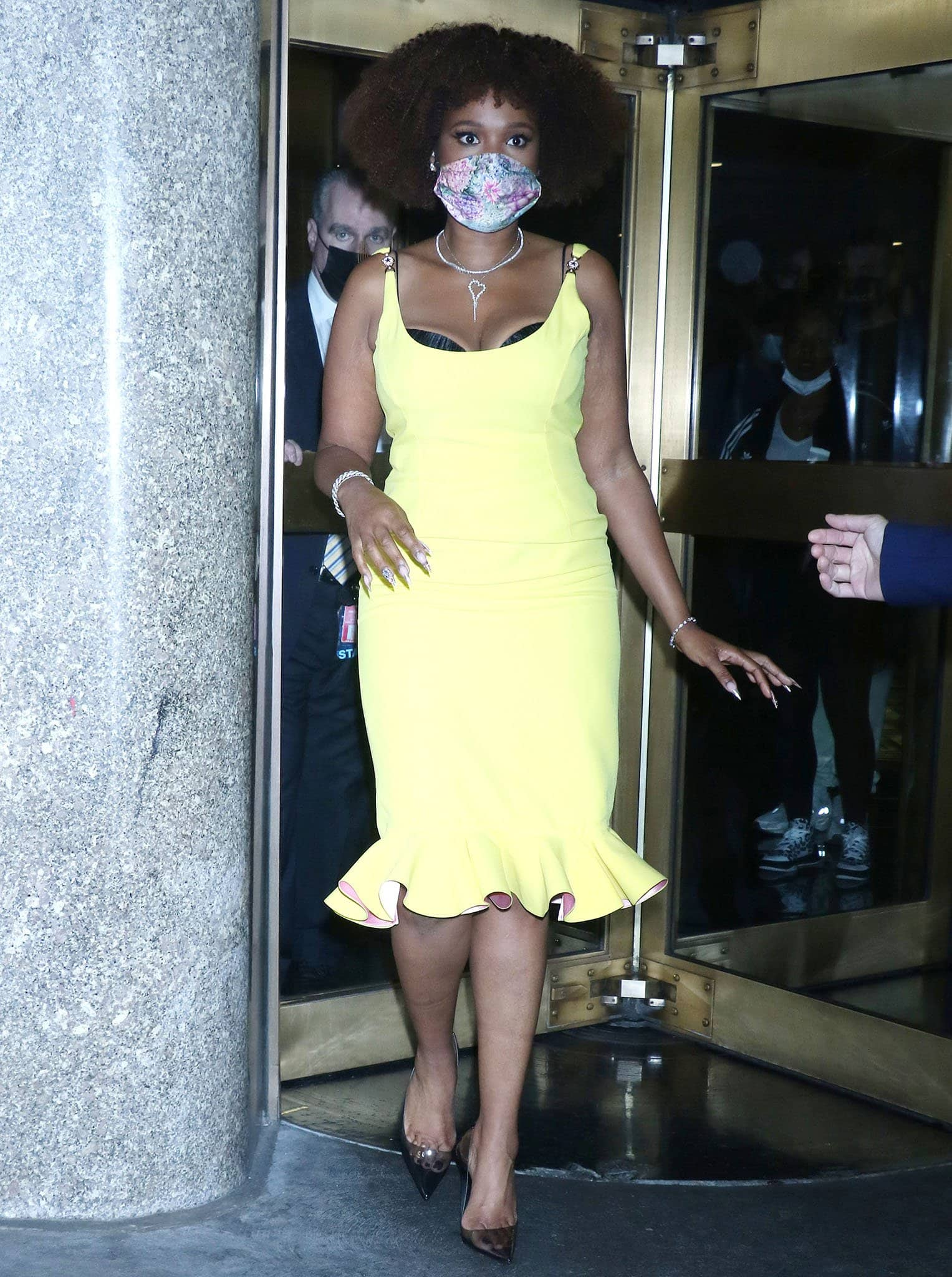 Jennifer Hudson shows off her figure in a yellow Versace Spring 2021 midi dress