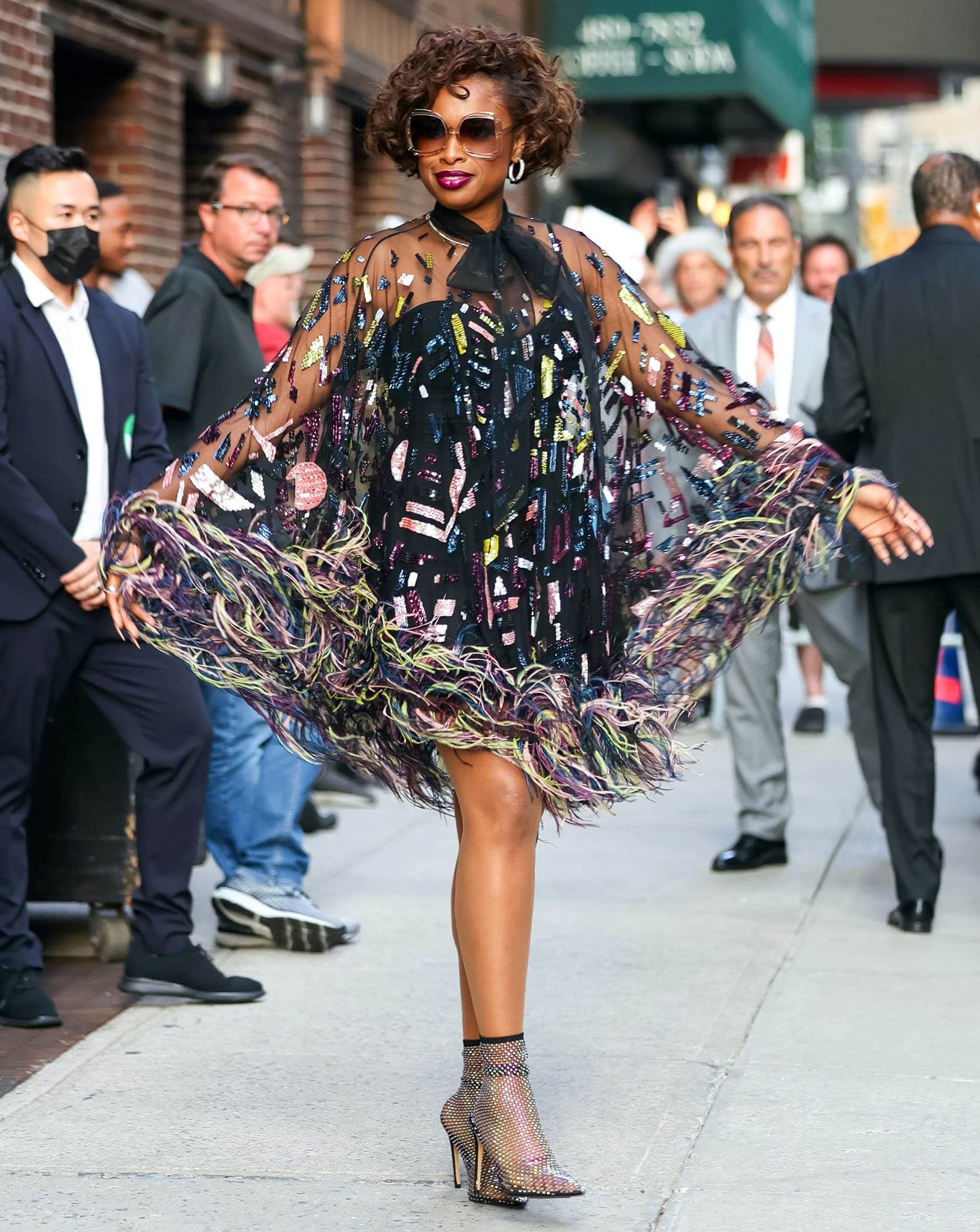 Jennifer Hudson wows in Zuhair Murad sheer mini dress with multicolored geometric sequins and a feathered hem