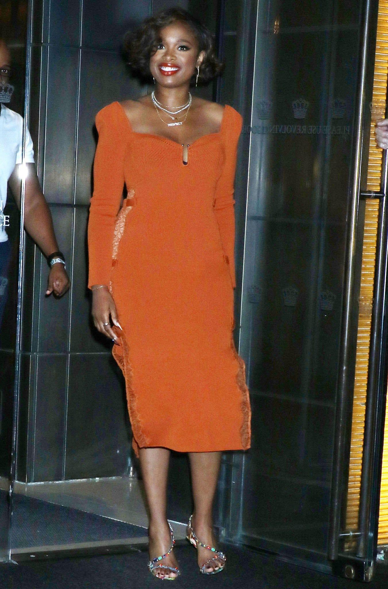 Jennifer Hudson leaving her NYC hotel in an orange ribbed midi dress on August 12, 2021