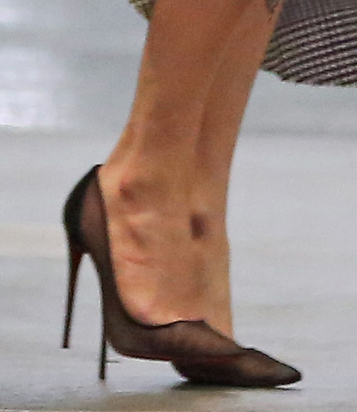 Jennifer Lopez completes her business-chic look with Christian Louboutin Follies Resille pumps