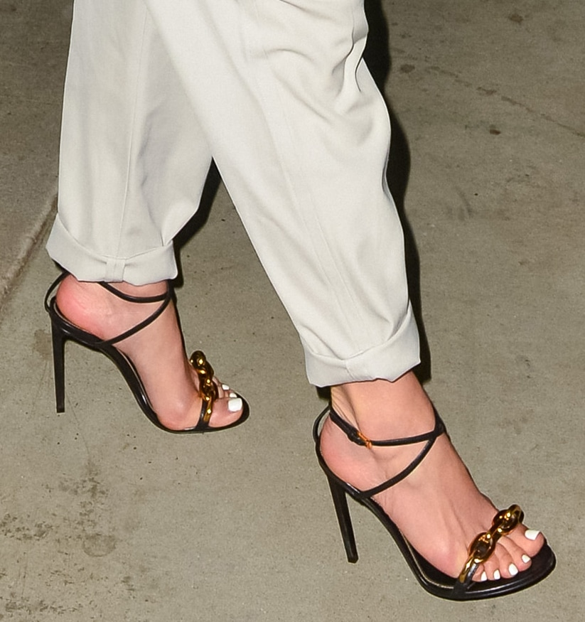 Jennifer Lopez adds height by showing off her feet in Tom Ford chain-detailed sandals