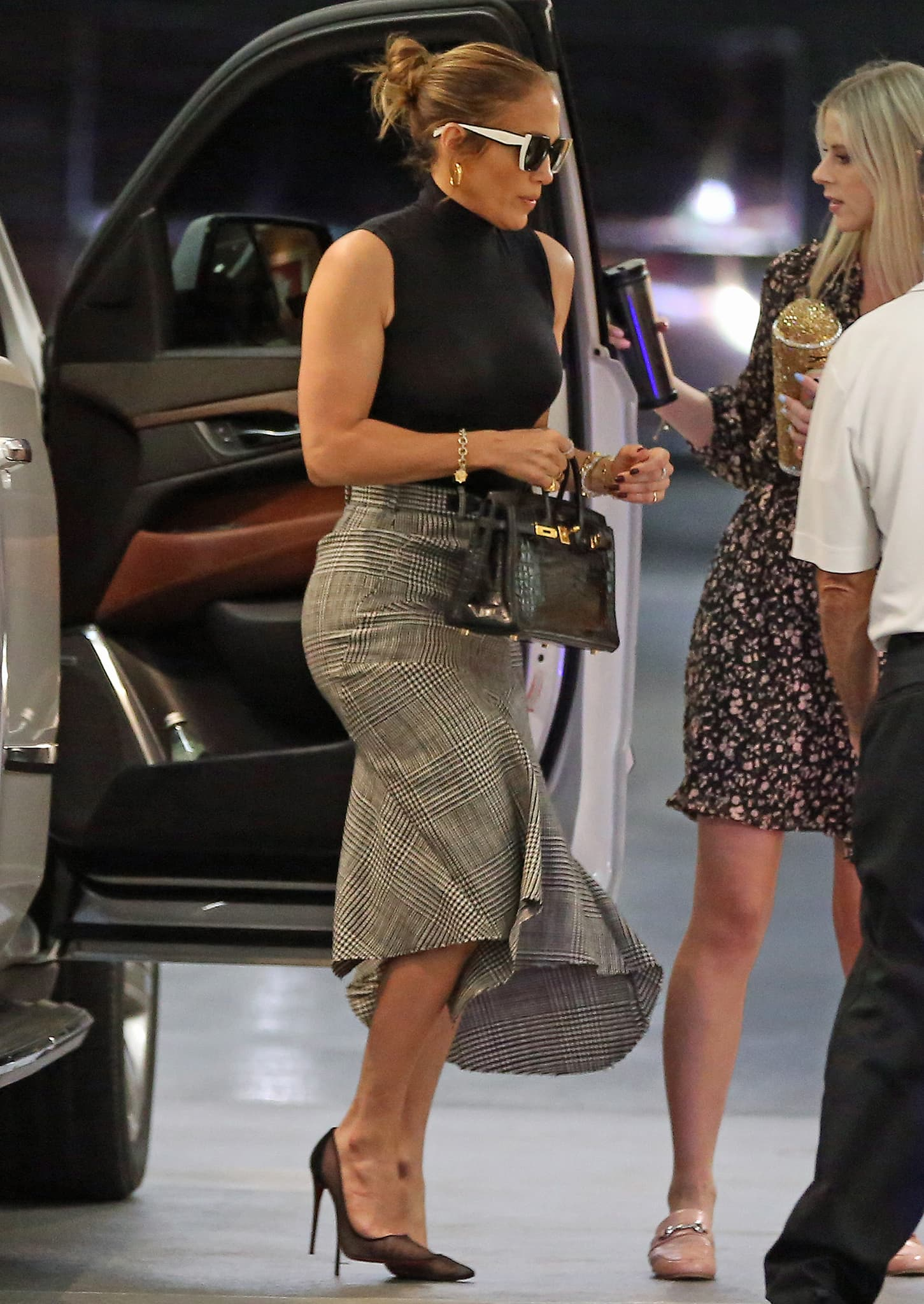 Jennifer Lopez is sophisticated in her Tom Ford plaid skirt and Wolford bodysuit