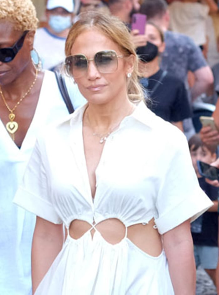 Jennifer Lopez ties her tresses into a ponytail and wears Gucci oversized sunglasses with nude lip color