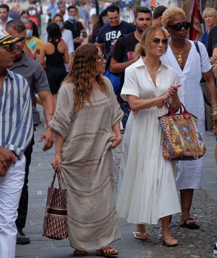 Jennifer Lopez pairs her flowy cutout dress with gold Havaianas flip-flops