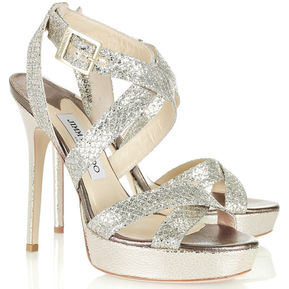 The Vamp is one of Jimmy Choo's most iconic styles with glittery crisscross straps, platforms, and stiletto heels