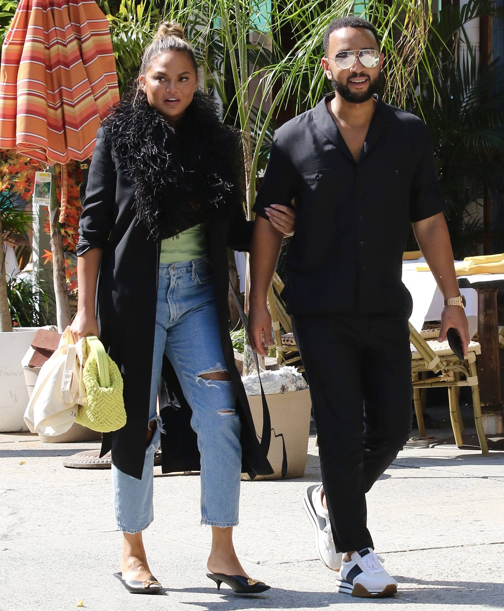 John Legend looks handsome in his black shirt, jeans, and Tom Ford James sneakers