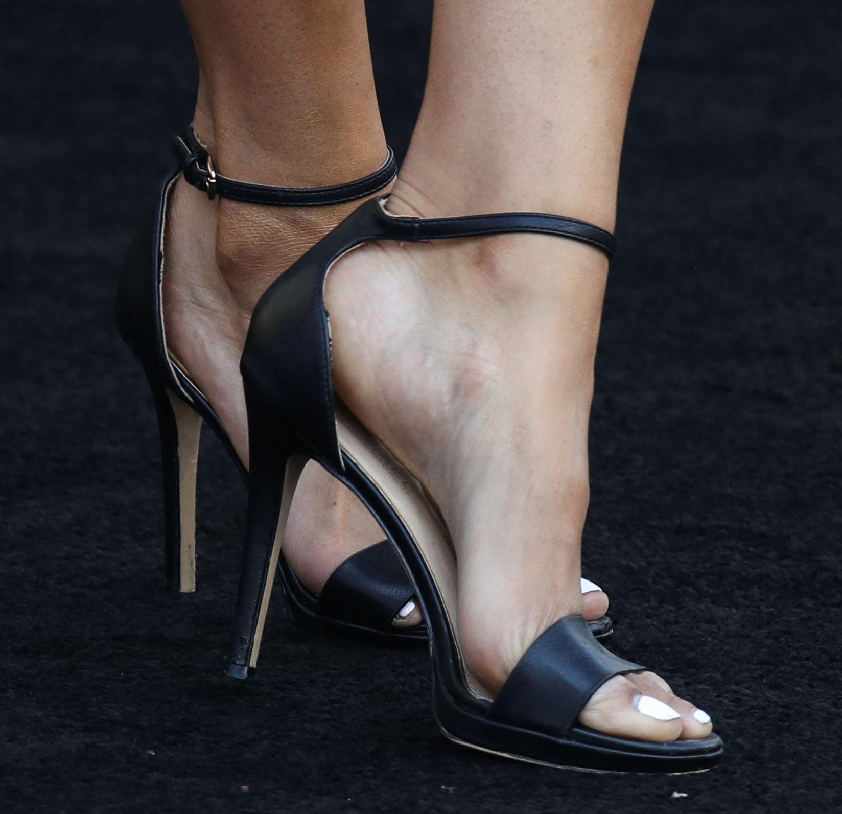 Jordin Sparks shows off her white pedicure in minimalist black open-toe heels