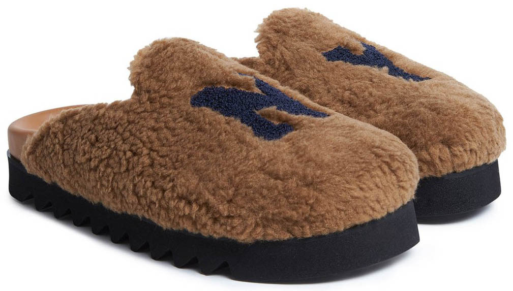These comfy mules have furry upper with brown calf leather insoles and black rubber soles