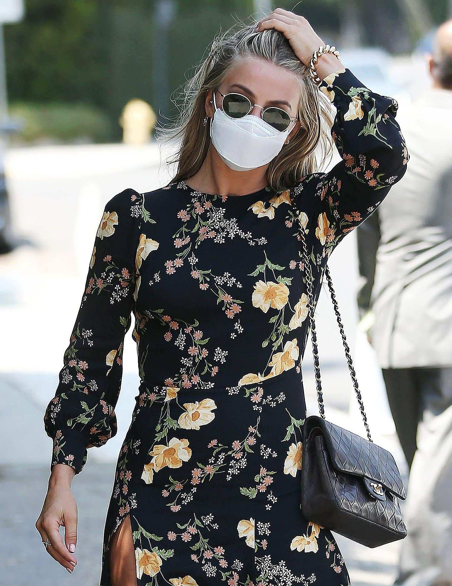 Julianne Hough hides her eyes behind her Celine sunnies and carries a black quilted Chanel bag
