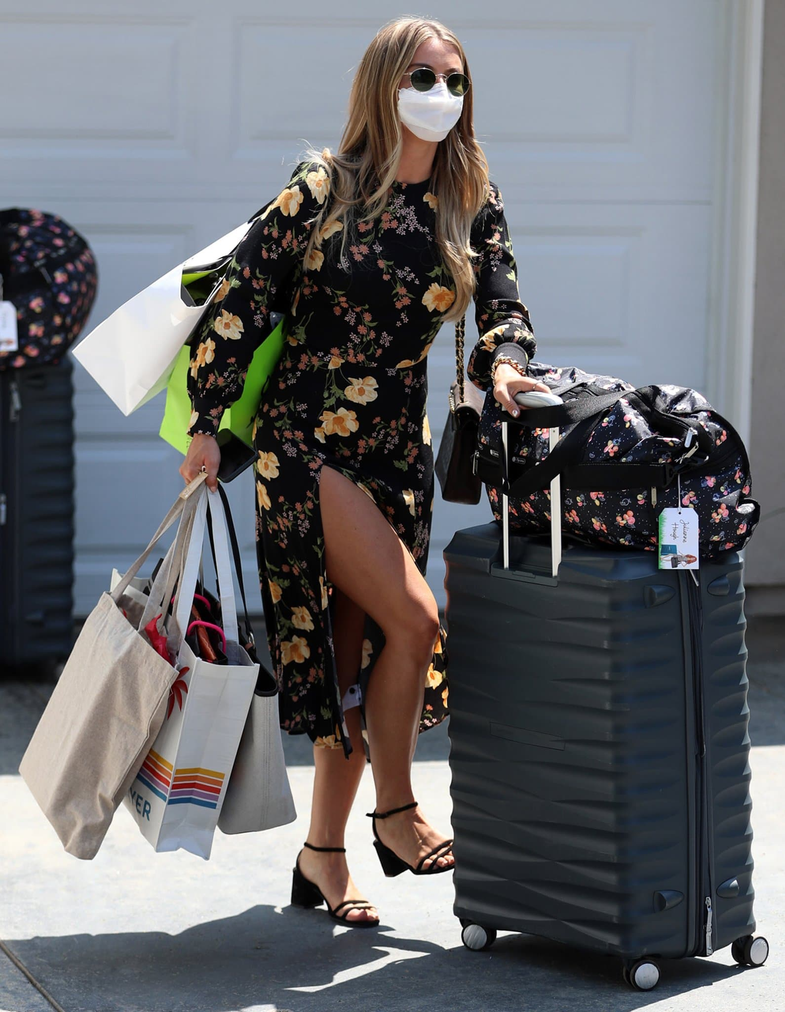 Julianne Hough flashes her legs as she leaves Jennifer Klein's home with bags full of goodies