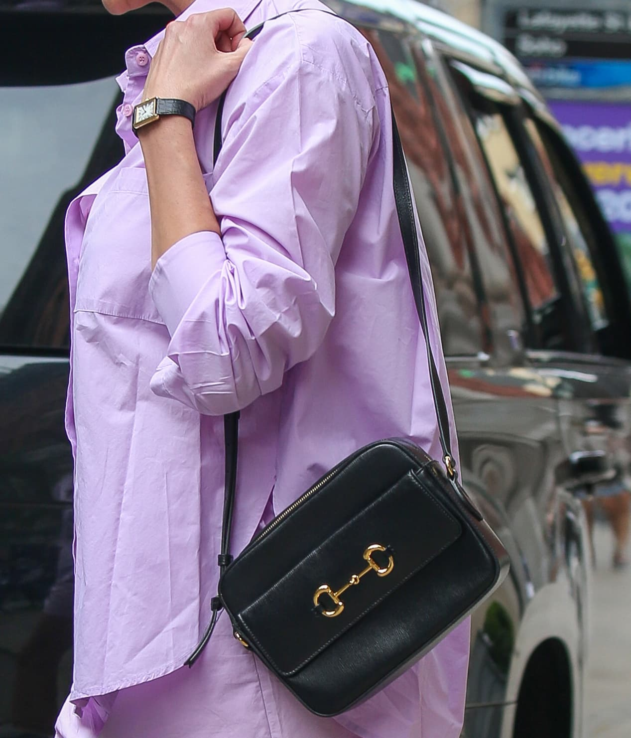 Karlie Kloss carries a Gucci Horsebit 1955 black leather bag from the vintage-inspired 1955 collection