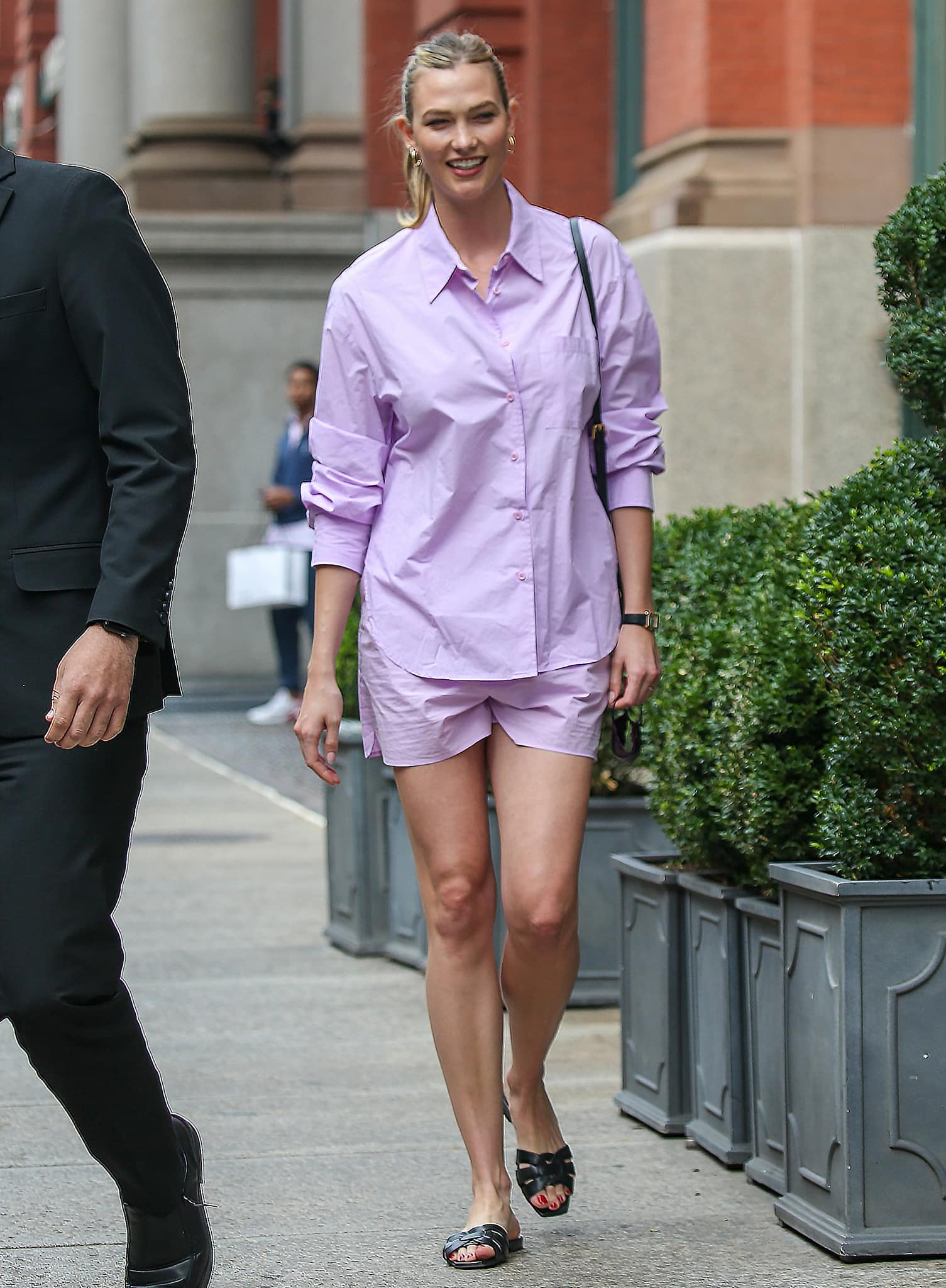 Karlie Kloss looks radiant in The Frankie Shop petal shirt and shorts set