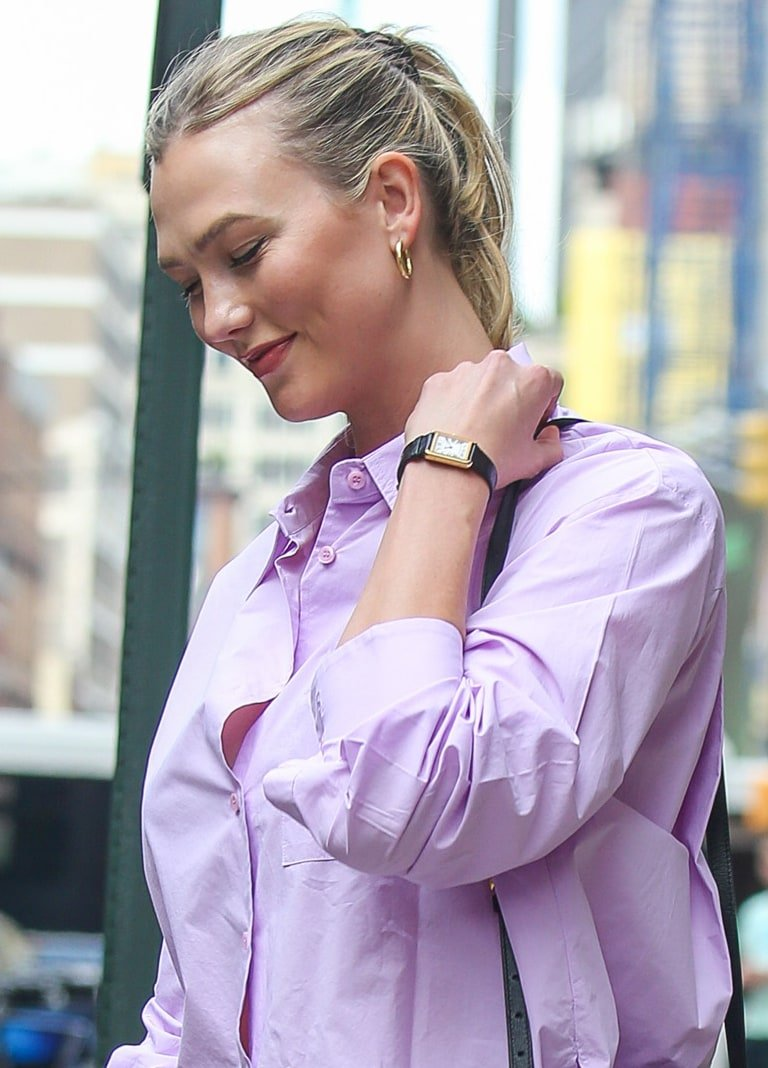 Karlie Kloss keeps an understated look with a casual ponytail and soft makeup