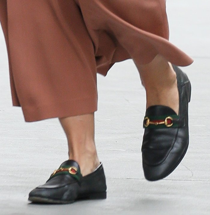 Katie Holmes teams her menswear outfit with Gucci loafers