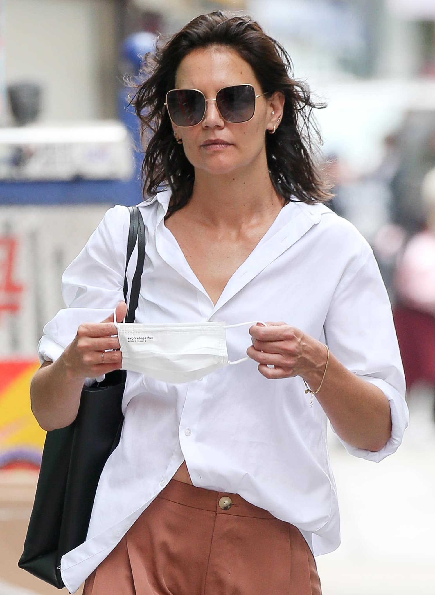 Katie Holmes lets her damp hair air-dry naturally as she stays low-key with oversized sunglasses and a white face mask