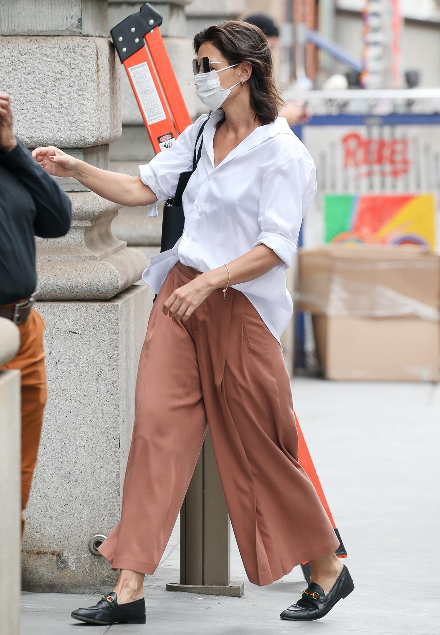 Katie Holmes nails a menswear-inspired outfit with an oversized white shirt and wide-leg trousers