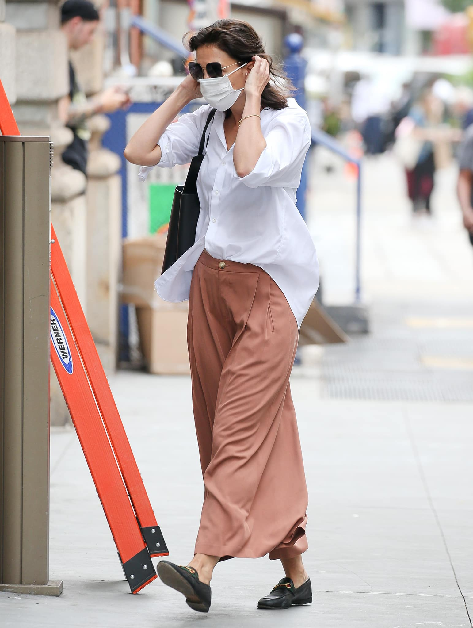 Katie Holmes does the French tuck styling hack for a flattering look