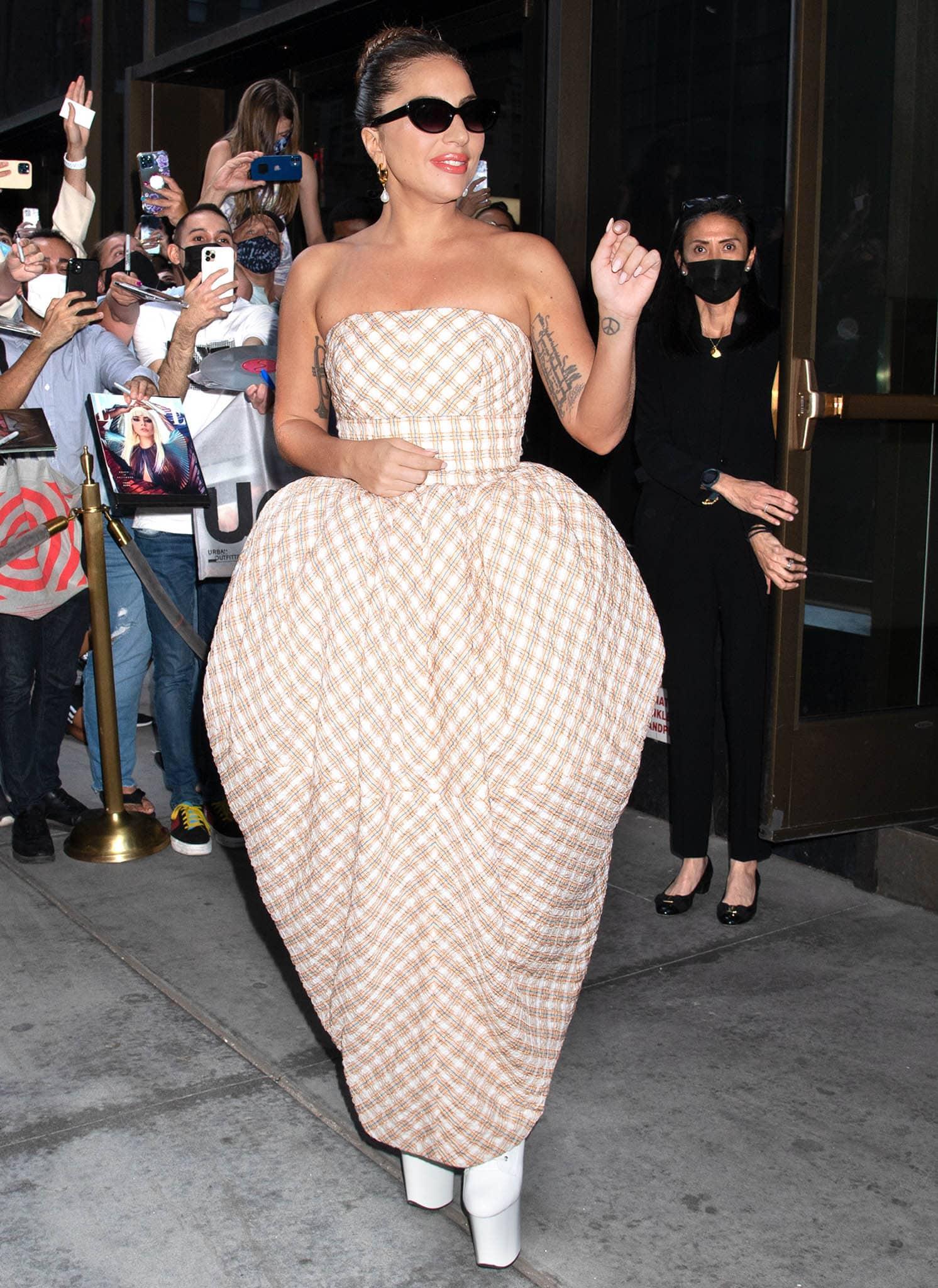 Lady Gaga wears a strawberry-shaped plaid midi dress from Christopher John Rogers