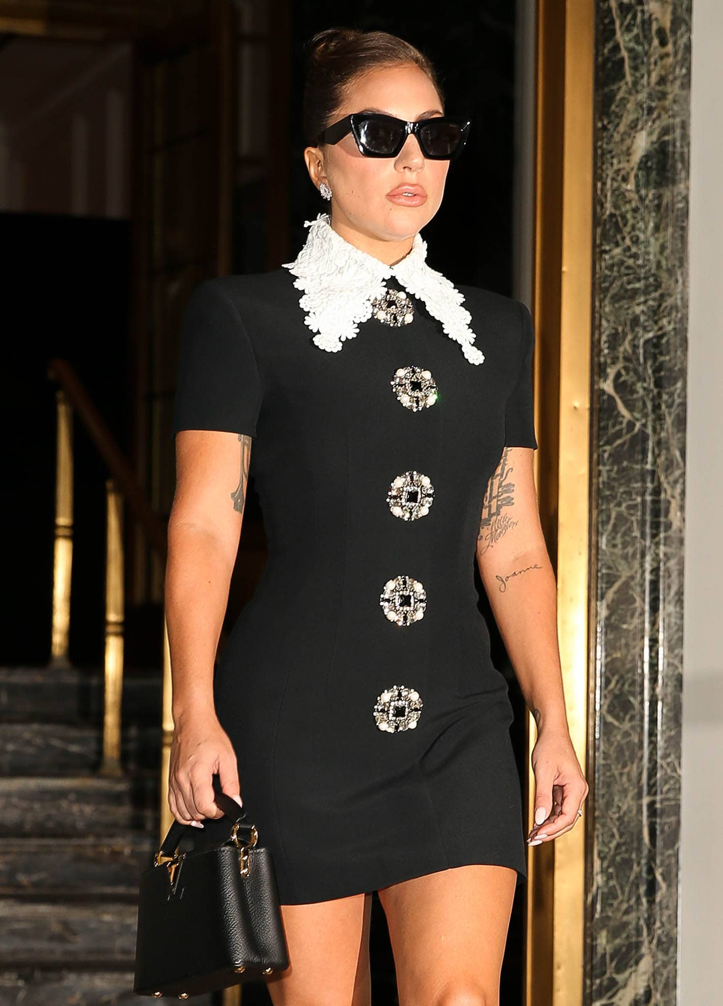 Lady Gaga pairs her mini frock with Louis Vuitton Capucines bag and cat eye sunglasses