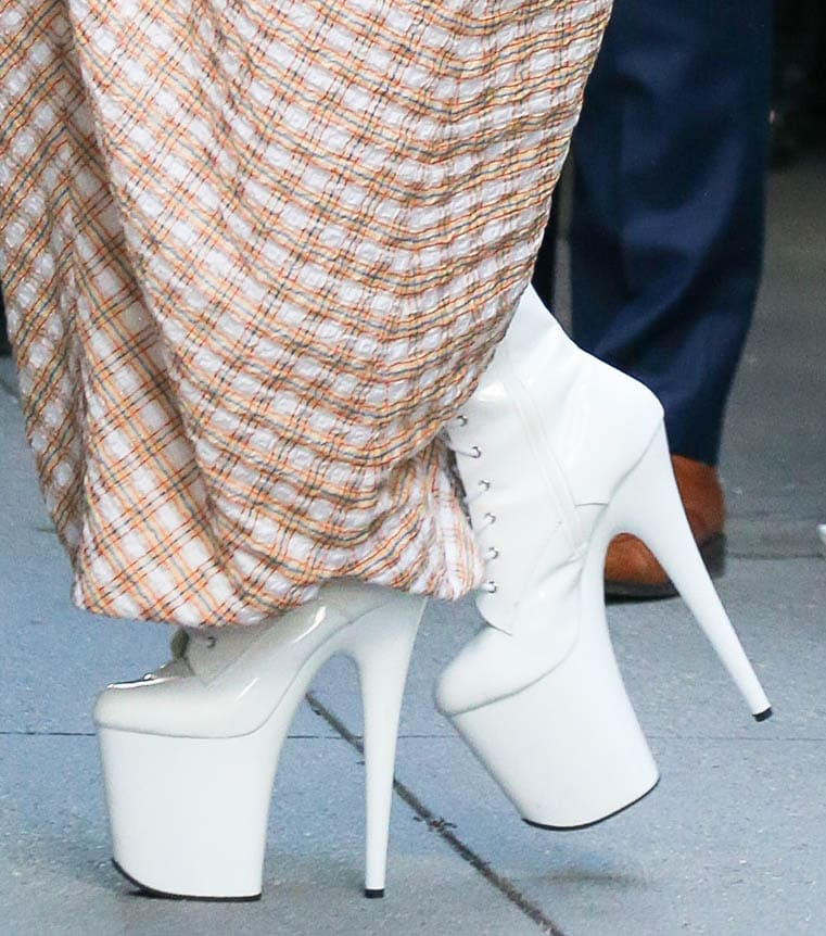 Lady Gaga pairs her unique dress with towering platform boots from Pleaser Shoes