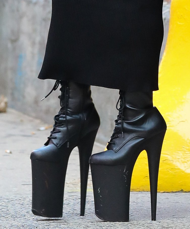 Lady Gaga teeters on a pair of Pleaser Infinity boots with monstrous 9-inch heels