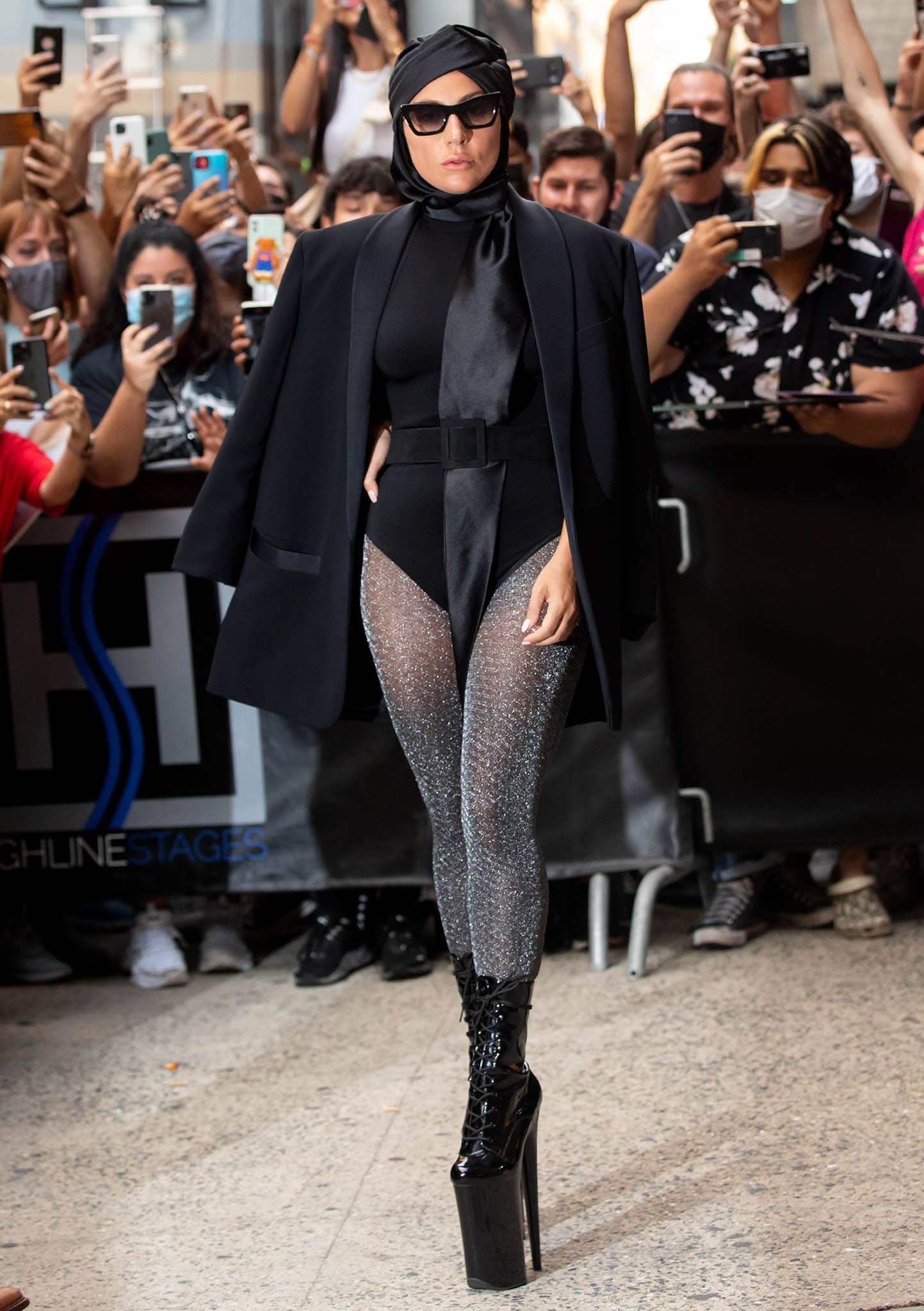 Lady Gaga flaunts her figure in a black bodysuit with Fogal lurex tights and an oversized blazer on July 28, 2021