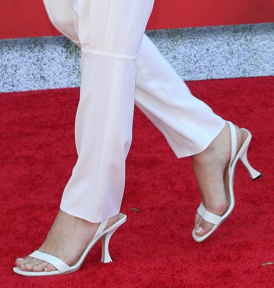 Margot Robbie completes her monochromatic ensemble with white By Far Lotta slingback sandals